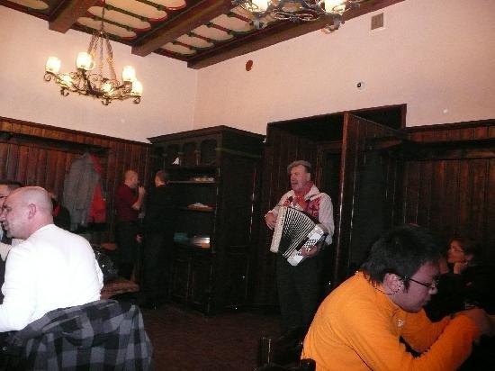 Restaurace U Fleku: Acordian player at U Fleku