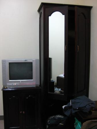 Tran Ly: cable tv and cabinet. to the left of the TV is the bathroom door