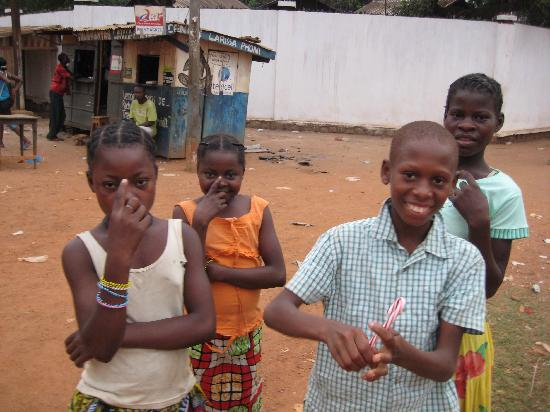 Bangui, Den Centralafrikanske Republik: Kids love candy canes, smiles all around!