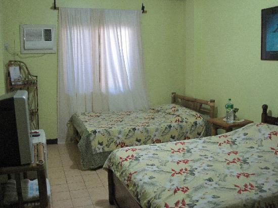 Blue Mango Inn: room on the right