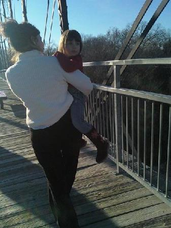 Faust Street Bridge: Leecia & Stella Manning walking on bridge, view of iron and walkway