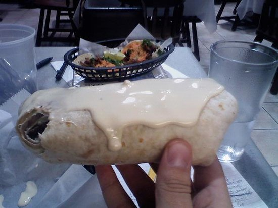 Taqueria Don Pedro: I had a burrito and tacos ( they are in the background) i added the cheese on the burrito it nor