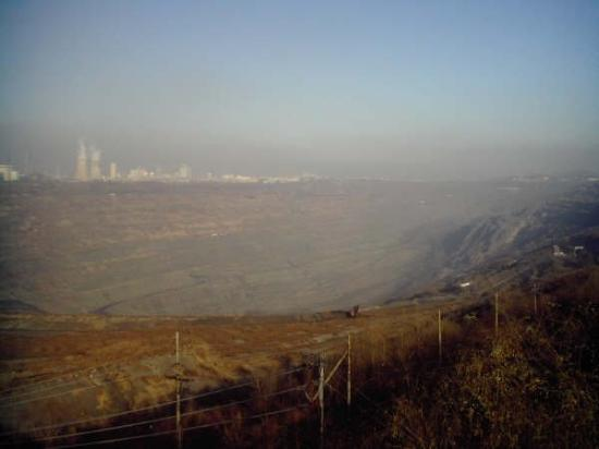 Coal mine outside Fushun with the city in the background