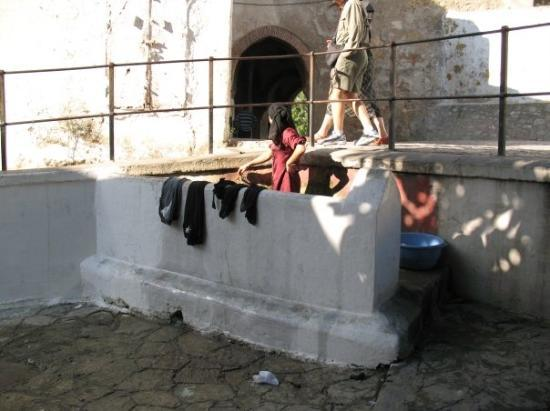 Medina of Tangier: Tangier, Morocco - woman washing clothes
