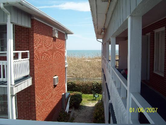 Surfside Lodge Oceanfront: the side of two buildings, with a view of the sand dunes and ocean