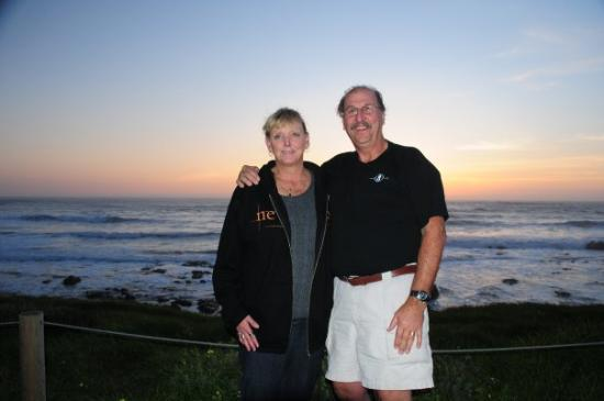 Cambria, CA: A very nice lady offer to take our picture as the sun set.