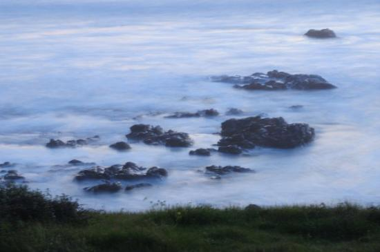 Cambria, CA: A long exposure makes the rocks look like the are floating in the clouds.