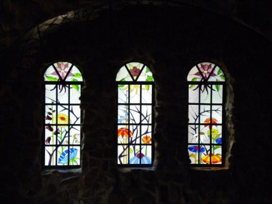 Rye, CO: Very beautiful stained glass window set on the first floor.