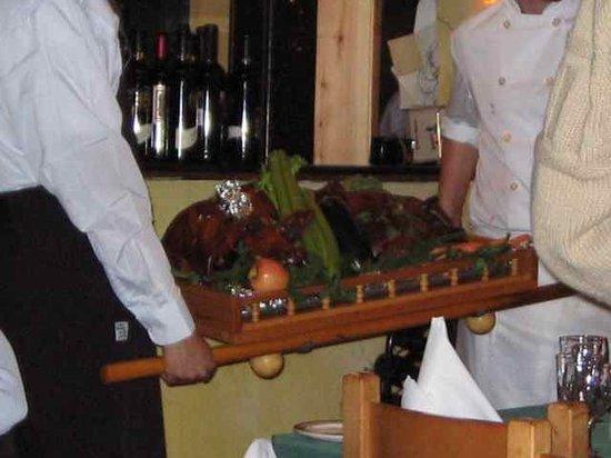 Osteria Napoli Ristorante: in comes the roasted pig!