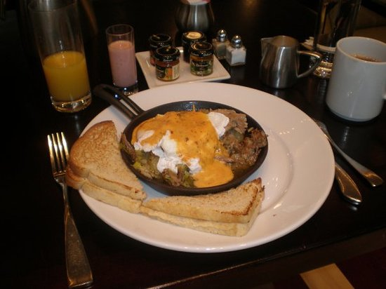 606 Congress: Another breakfast..at the Renaissance .. Egg benedict with Chipotle Hollandais sauce...over duc