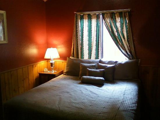Sleepy Hollow Cabins and Hotel : Bedroom, king-size bed -- and all that pine!