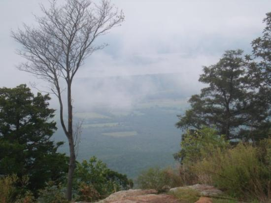 a cloud covered view of the valley Mt. Magazine over looks