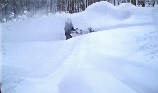 Dixmont, ME: Snowblowing a path from our back door to the firewood in our barn. March 2009