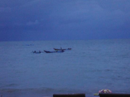 Fisherman inthe storm at Jimbaran bay