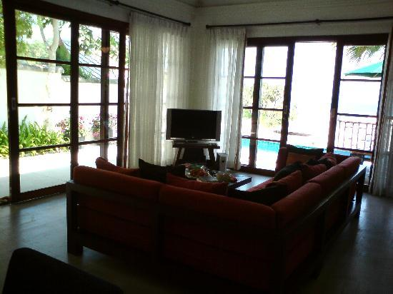 Kanda Residences: Living room view of pool