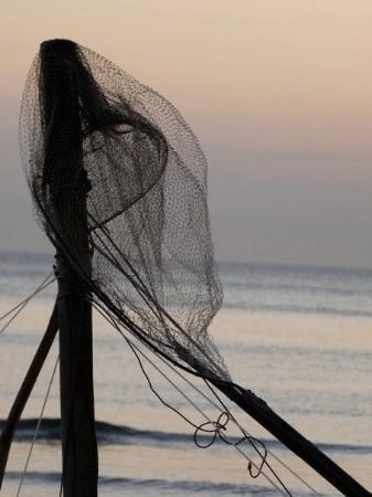 Sipalay, Filippine.Sugar beach al tramonto, i pescatori partono