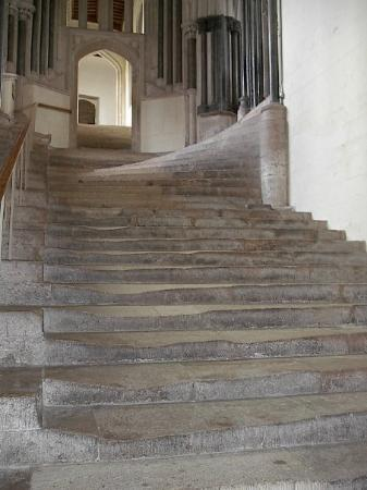 Wells Cathedral: Stairs to Sisters chapter house. Wierdly shaped and extremely worn. In use since 1306.