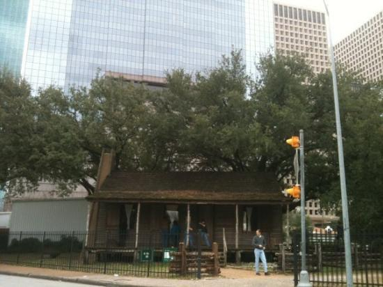 The Heritage Society: Old Cabin @ Houston Heritage Park with Houston skycrappers at background