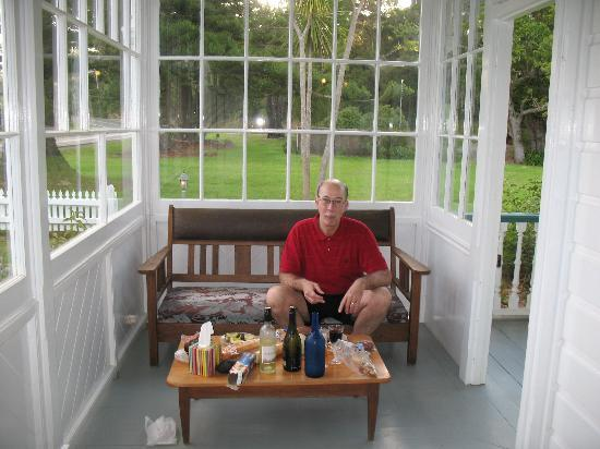 Ounuwhao Harding House: My husband enjoying cheese, meat, bread and wine on the porch.  It was such a delight that we we