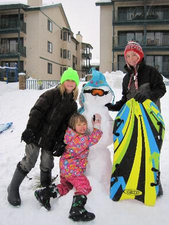 Sledding and snowman building in front of Lagonita Lodge