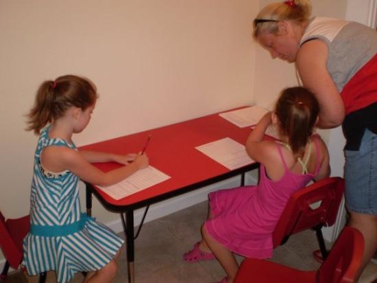 Santa's Candy Castle: The girls write the letters to Santa.  Emily instructed Momma what to write for her.