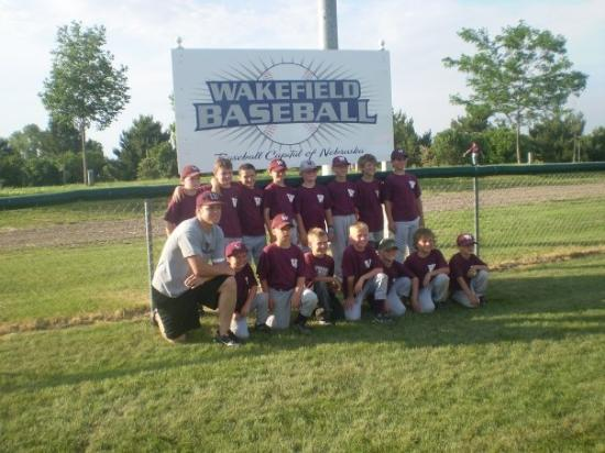 my son brandons peewee baseball team by wakefield sign after placeing second in wooden bat tourn