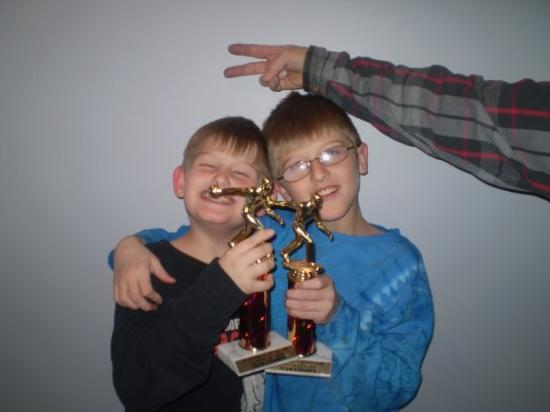 Wakefield, NE: michael and brandon with marks arm with bowling trophy