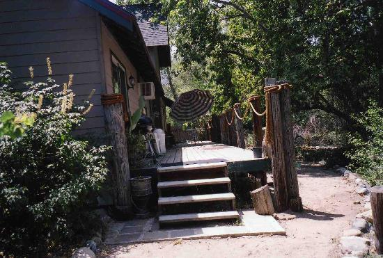 RiverFront Cabins Kaweah General Store: large family cabin, deck and backyard on the river