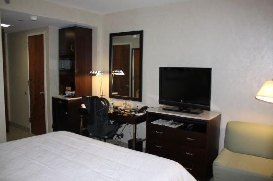 King Bed TV and Desk Picture of Hilton Garden Inn New YorkWest
