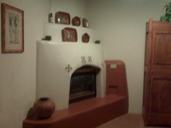 Blue Sky Retreat at San Geronimo: The kiva fireplace in my room.  It's idiot proof, simple on/off for a cozy gas fire.