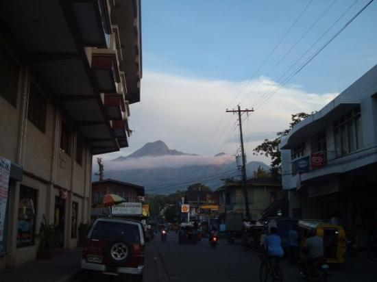 Mambajao, Philippines: tip of one of the 3 Volcanoes rising above the clouds, taken from downtown Mabajao.