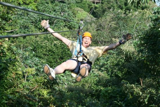 Roatan, Honduras: Look mom, no hands! We zipped 1.5 miles of cable that day. We literally went from one treetop to