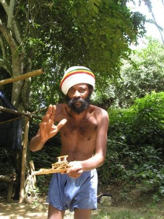 Montego Bay, Jamaica: some guy selling us a mini bamboo boat