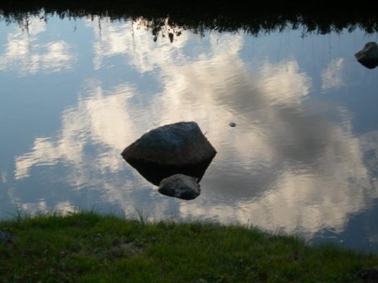 Gorham, NH: Clouds reflected in river at foot of Mount Washington.