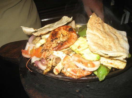 Omar Inn : The seafood kofta was amazing - grilled fish, prawns and squid and served on a sizzling plate wi