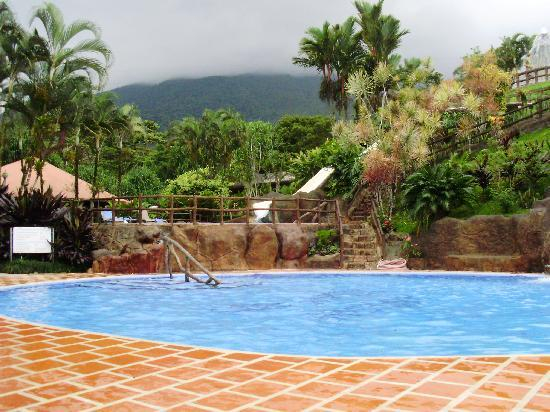 view of arenal volcano from pool (clouded over)