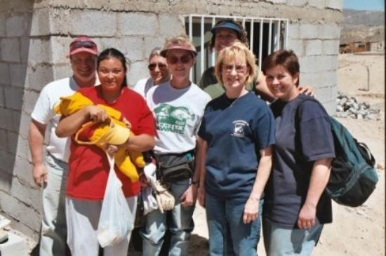 Ciudad Juarez, Mexico: Mission trip to Juarez - the home's new owner in red.