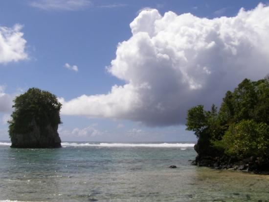 Pago Pago, American Samoa. Fatu-ma-futi rock formation on the beach. There's a tale to tell abou