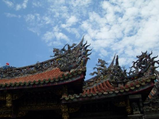 Longshan Temple: I love the blue sky against the dragons on the roof.
