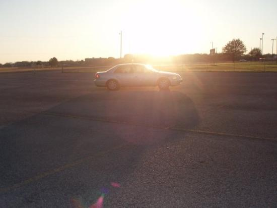 Commerce, TX: Sunset behind the car