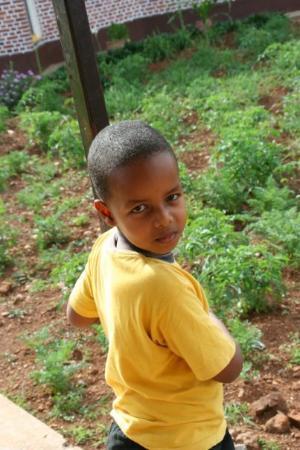 Rwanda, Kigali, St. Paul, Home, Neighbor, very adorable cute boy. Delan