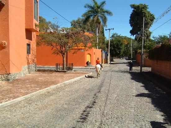 Riding down senic cobble stone street