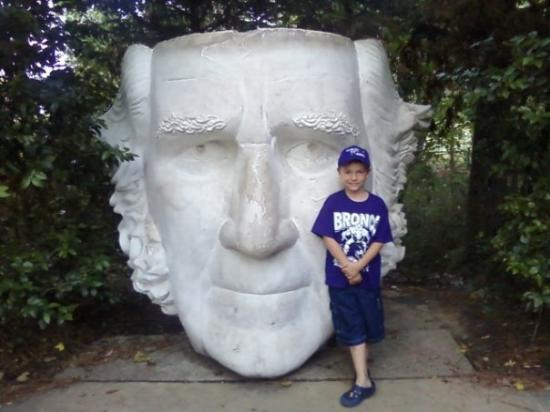 Huntsville, TX: Luke with face of Sam Houston statue