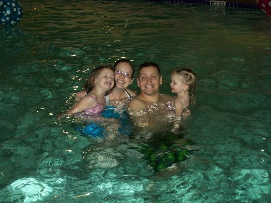 BEST WESTERN Liberty Inn DuPont: Swimming with his wife and daughters in hotel pool.