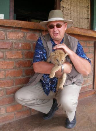 Harare, Zimbabwe: Rick with little cub at a local refuge.