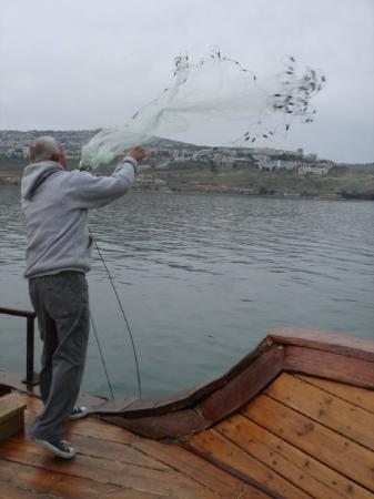 Tiberias, Israel: Casting the net to fish at the Sea of Galilee
