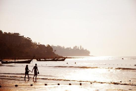 Kamala Beach: Couple walking along the beach at sunset