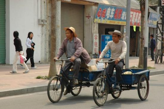 Tricycling friends in Dongguan, China.