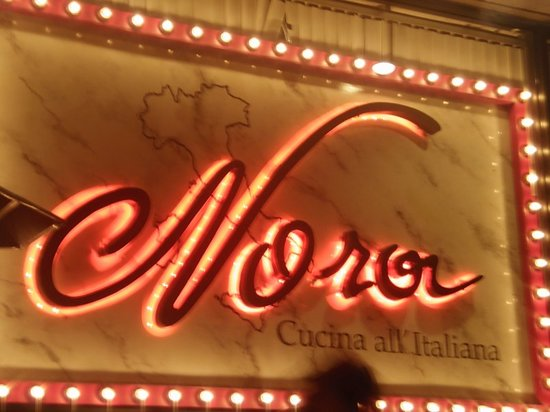Nora's Cuisine: Neon sign of happiness