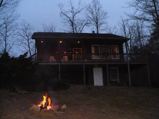 Cottages at Chesley Creek Farm: Front view of cabin with fire